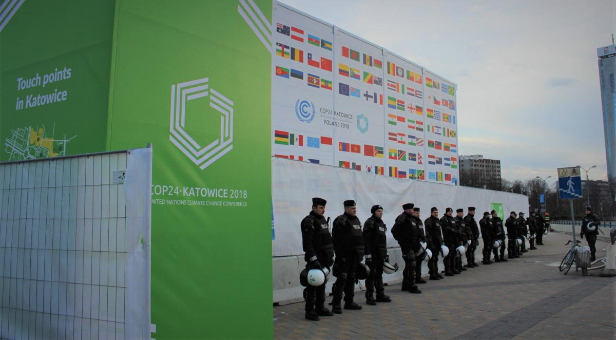 Police stationed outside COP24 during the Climate March.